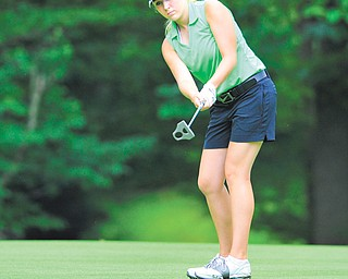 Alexa Tringhese of Columbiana watches her ball break toward the cup on the 14th hole at Diamond Back Golf Course in Canfield during Monday's junior qualifier for the Greatest Golfer of the Valley tournament.