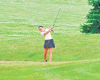Gina Cerimele of Canfield chips her ball out of a wet sand trap and toward the green on the seventh hole at Diamond Back Golf Course in Canfield during Monday's junior qualifier for the Greatest Golfer of the Valley tournament.