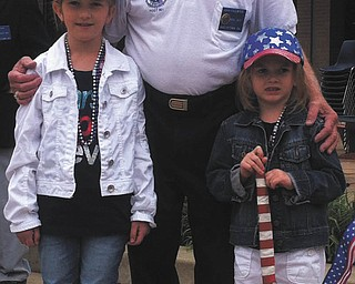Elisabeth and Madeline Facemyer of Canfield, with John Facemyer of Austintown, their grandfather and a veteran. Submitted by Dr. Gregory J. Facemyer.