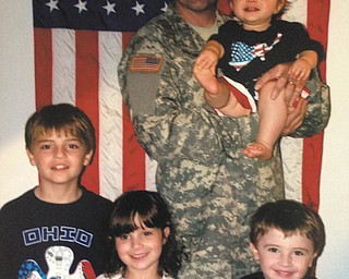 Cpl. Michael Polombi, son of Cookie and Anthony Polombi, holding a nephew, Tommy Strain. From left are Anthony Polombi, Michael's son; Gina Strain, his niece; and Colin Polombi, also Michael's son. Michael is serving in the U.S. Army and is stationed in Watertown, New York, with his wife, Jennifer (Silver) Polombi, Anthony, Colin, and Alexander, born June 2. Submitted by Cookie Polombi.