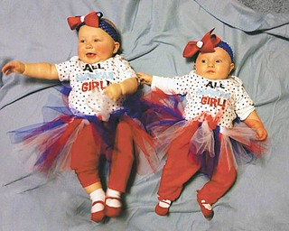 "Allie Snyder of Toledo and Leigha Quiring of Medina dawn red, white and blue at a family picnic in Girard. Though the girls are technically third cousins once removed, their large, Italian family in the Youngstown area feels ""a cousin's a cousin."" Sent by Allie's great-grandmother, Rita Finelli."