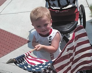 This cutie is really enjoying waving our red, white and beautiful flag!