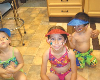 Getting ready for the Struther's Fourth of July Parade in 2012 which passes by MaMa Deem's house are Sadie Jones of Youngstown and Corinne and Joshua Deem, both of Boardman. Submitted by Dee Deem of Struthers, their grandmother.