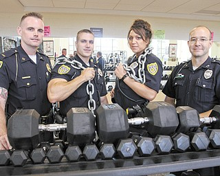 Youngstown police officers who recently passed the department's voluntary physical-fitness program include, from left, Lt. Frank Rutherford, Patrolman Nick Bailey, Patrolwoman Jessica Shields and Patrolman George Anderson