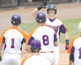 Creekside's Zac Miller (15) is congratulated by teammates, including Harrison Wagner (1) and Brandon Ritchie (8) after hitting a solo home run in second inning of Game 1 of their Class B semifinal doubleheader against Toyota of Warren on Thursday at Cene Park in Struthers. Creekside won both games, 6-3 and 4-3, to advance to the championship against the Astro Falcons.