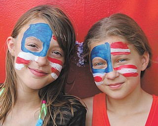 Maddie Fall and Anna Buffone (Leetonia) are at the Columbiana Fourth of July celebration last year. The photo was taken by Nicole Buffone.