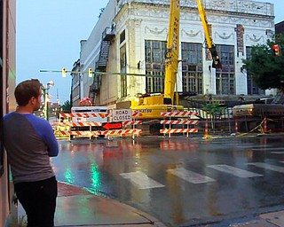 William d LEwis The Vindicator  Nicholas Serra watchesas demo of the historic Paramount Theater gets underway Monday night. A parking lot will be built on hte site at Hazel and W,Federal in dowtown Y-town.