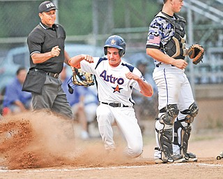 Astro Falcons baserunner Vinny Ruberto slides in behind Ohio Glaciers catcher Jake Smith to score in the first inning of Game 2 of the Little b championship Monday at Cene Park in Struthers. The Falcons led 3-0 when play was suspended by lightning in the second inning.