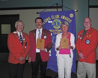 SPECIAL TO THE VINDICATOR Boardman Lions Club presented the Knight of the Blind Award to two four-year members at the group's 45th charter anniversary dinner meeting June 20 at Cafe 422 in Boardman. Above, from left, are John Woodside, district governor; Terry Shears and Judy Jones, recipients of the award; and Bill Rausch, zone chairman. Perfect attendance awards also were given to 20 members. For information about the Boardman Lions visit Facebook or www.boardmanlions.com or email boardmanlions@hotmail.com.