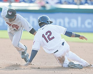 The Scrappers' Claudio Bautista (12) is tagged out by Tri-City second baseman Tony Kemp while trying to steal in the second inning of the first game of a doubleheader Thursday night.