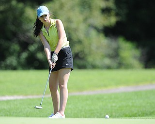 Katie Hall of Niles follows through on her putt as it breaks toward the hole on the 8th hole Friday morning at Tamer Win in Cortland.
