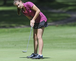 Mary Hunt of Poland follows through on her putt on the 11th hole Friday morning at Tamer Win in Cortland.