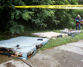 MADELYN P. HASTINGS | THE VINDICATOR  Burned mattresses were placed outside at 47 7th street in Campbell where a 5 victim shooting and fire occurred on Saturday, July 20.
