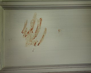 MADELYN P. HASTINGS | THE VINDICATOR  A bloody handprint was found at 37 7th Street in Campbell, directly next door to 47 7th Street where a 5 victim shooting and fire occurred on Saturday, July 20.