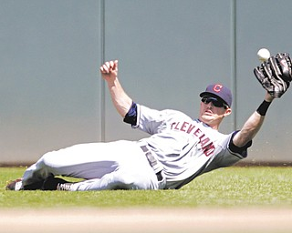 Indians center fielder Drew Stubbs misses a broken-bat blooper by the Twins' Brian Dozier, ending starter Justin Masterson's chance for a no-hitter during the seventh inning of Sunday's game in Minneapolis. The Indians downed the Twins, 7-1, to avoid being swept.