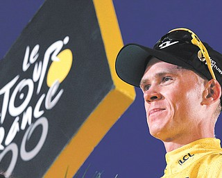 Britain's Christopher Froome celebrates his win of the 100th Tour de France on Sunday in Paris.