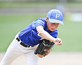 Poland pitcher Brody Todd throws a pitch during the bottom of the 3rd inning.