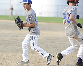 Mill Creek infielder #24 Dom Montalbano steps on first base to force out base runner #23 Patrick Donofrid during practice Sunday night.