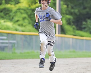 Mill Creek base runner #23 Patrick Donofrid sprints to touch home plate during practice Sunday night.