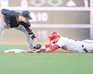 Pittsburgh Pirates second baseman Neil Walker, left, tags out Washington Nationals' Bryce Harper as he tried to steal second base during the first inning of a game Tuesday in Washington.