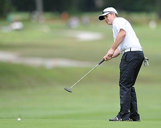 Joey Shushok of Fitch follows through on his putt on the 18th hole Wednesday afternoon at Mill Creek Golf Course.