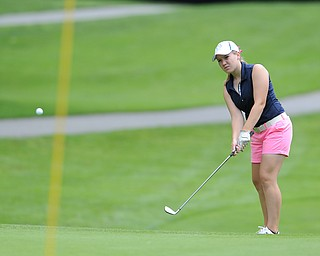 Kerra Loomis of Canfield chips her ball on to the green on the 8th hole Wednesday afternoon at Mill Creek Golf Course.