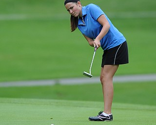 Melinda Hannon of Poland follows through on her putt on the 8th hole Wednesday afternoon at Mill Creek Golf Course.