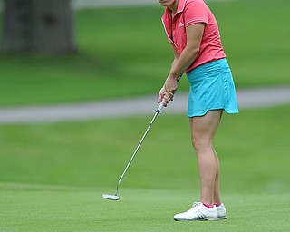 Olivia DeMartino of Canfield watches as her ball breaks toward the hole on the 8th hole Wednesday afternoon at Mill Creek Golf Course.