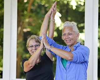 MADELYN P. HASTINGS | THE VINDICATOR  (L-R) Beth Ernest and Carol Opatken participate in a yoga class at the Fellows Riverside Gardens in Mill Creek Park on Thursday, July 25. Pilates and tai chi are also offered through the 'Scenic Fitness Workshop'.