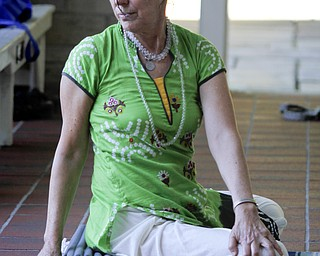 MADELYN P. HASTINGS | THE VINDICATOR  Karres Cvetkovich teaches a yoga class at the Fellows Riverside Gardens in Mill Creek Park on Thursday, July 25. Pilates and tai chi are also offered through the 'Scenic Fitness Workshop'.