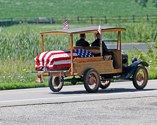 ROBERT K. YOSAY  | THE VINDICATOR  A few of the 40+ vehicles followed the Model T  south on 45 to 224 and west to cemetery  Friends, family, and colleagues of 21-year-old Dylan Crump, who died in a one-car accident July 21, Dylan was taken to his resting place, at West Berlin Center Cemetery, in a family heirloom. Dylan's Model T, which was left to him by his grandfather, who passed away in 2011, carried him the ten miles between the funeral home and the cemetery.