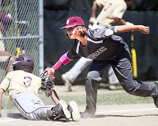 William D. Lewis the Vindicator  Boardman's Cameron Kreps(2) tries to tag New Albany's Nick Shroyer(3) during a first inning pickoff attempt Friday in Ashtabula.