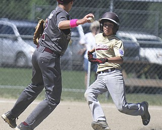 William D Lewis The Vindicator  Boardman's Travis Harvey(2) attempts a double play while New Albany's Jacob Snyder(1) is out at 2nd during Friday action in Ashtabula.