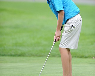 Daniel Lapolla of Warren follows through on his putt on a hole on the back 9 Sunday afternoon at Trumbull Country Club.