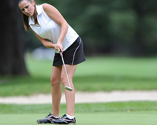 Melinda Hannon of Poland follows through on her putt on a hole on the back 9 Sunday afternoon at Trumbull Country Club.