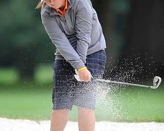 Kaylee Neumeister works on chipping her ball out of a sand trap on a hole on the back 9 Sunday afternoon at Trumbull Country Club.