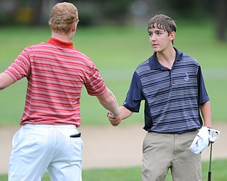 Billy Colbert of Hermitage shakes hands with Nolan Snyder after winning on a playoff hole Sunday afternoon at Trumbull Country Club.