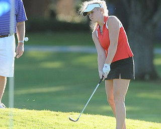 Rachel Williamson chips her ball onto the green on the 18th hole Sunday afternoon at Trumbull Country Club.