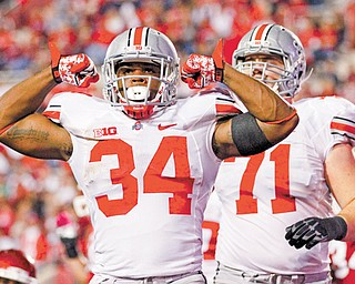 Ohio State running back Carlos Hyde celebrates after scoring a touchdown against Indiana. Columbus police announced Tuesday that an investigation involving Hyde has been closed.