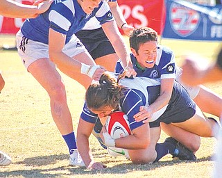 Former East Palestine High School standout Liz Strohecker, right, makes a tackle during a 2012 match with the San Diego Surfers. Strohecker, who started playing rugby in college at the University of Connecticut, has been part of three national championship teams (2009, 2010 and 2012) with the Surfers.