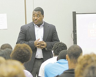 Guy Burney, coordinator of the Community Initiative to Reduce Violence, talks to a group of juveniles with a history of anti-social behavior at Mahoning County School in Youngstown on Wednesday.