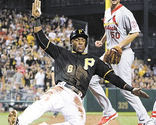 The Pirates' Starling Marte (6) scores from third on a sacrifice fly by Andrew McCutchen in the fifth inning