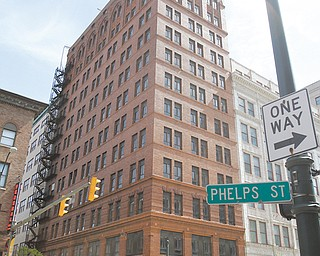 Developers plan a $15 million renovation of the vacant Wick Building on West Federal Street for a 52-unit rental and extended-stay facility.