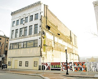 Developers plan a $5 million renovation of the vacant Wells Building on West Federal Street for offices and a 12-unit apartment complex.