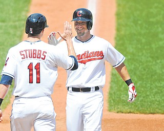 Cleveland Indians right fielder Ryan Raburn, right, celebrates his two-run home run with center fielder 