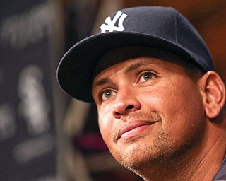 The Yankees' Alex Rodriguez listens during a news conference before Monday's game against the Chicago White Sox in Chicago. Rodriguez and 12 other players were suspended by MLB effective immediately for their parts in the Biogenesis drug scandal.