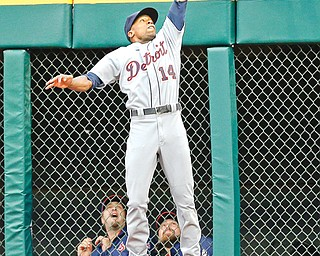 Tigers center fielder Austin Jackson makes a leaping catch in front of the Indians bullpen to rob Cleveland's Lonnie Chisenhall of a home run in the second inning of Monday's baseball game in Cleveland. The Indians were three outs away from downing the AL Central leaders when Alex Avila hit a three-run shot off Indians closer Chris Perez to boost Detroit to a 4-2 win.