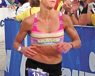 Jessica Marino, a 2000 graduate of Poland High School, nears the finish line at the Ironman event in Lake Placid, N.Y., on July 28. Marino, who lives in New York, placed fourth at the event and qualified for the 35th Ironman World Championship, which is set for Oct. 12 in Kailua-Kona, Hawaii.