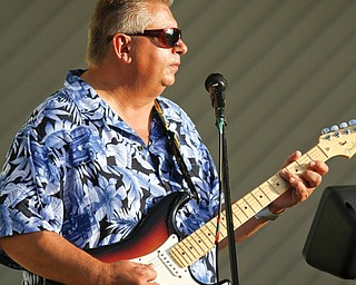 MADELYN P. HASTINGS | THE VINDICATOR..Larry McDevin plays the band Uptown Saturday Night at the Austintown National Night Out in the Austintown Township Park on August 6, 2013. This is the first year Austintown participated in the National Night Out hosted by the police department and the trustees. ... - -30-..