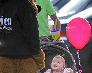 MADELYN P. HASTINGS | THE VINDICATOR..Sydnee Carpenter, 1, of Austintown smiles at the 'Jim Sobien for Austintown Board of Elections' dog at the Austintown National Night Out in the Austintown Township Park on August 6, 2013. This is the first year Austintown participated in the National Night Out hosted by the police department and the trustees. ... - -30-..